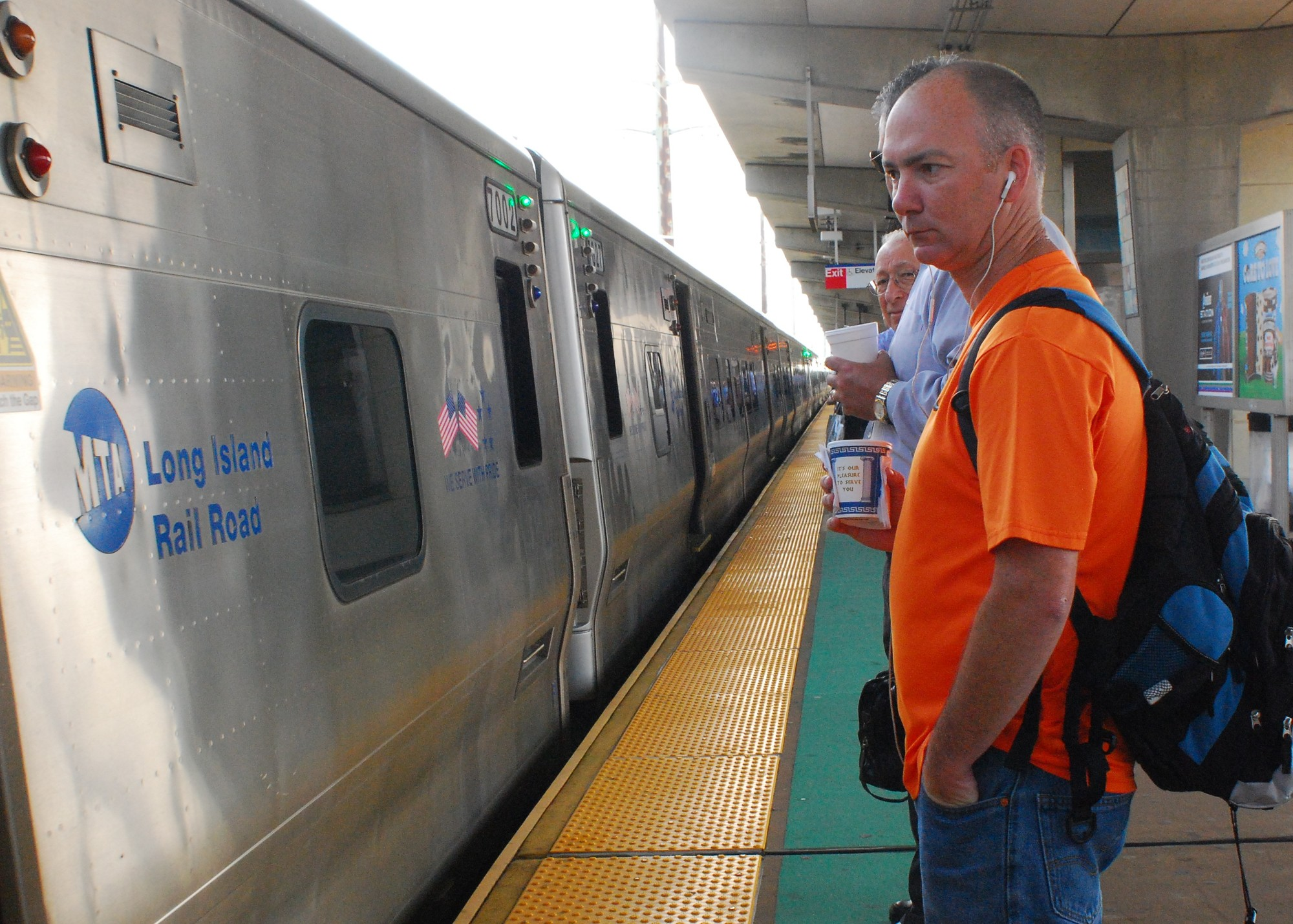 Dave Francis, front, of Bellmore, said that he's starting to worry that there will be a Long Island Rail Road strike on July 20. Above, Francis prepared to board a train in Bellmore on Monday.