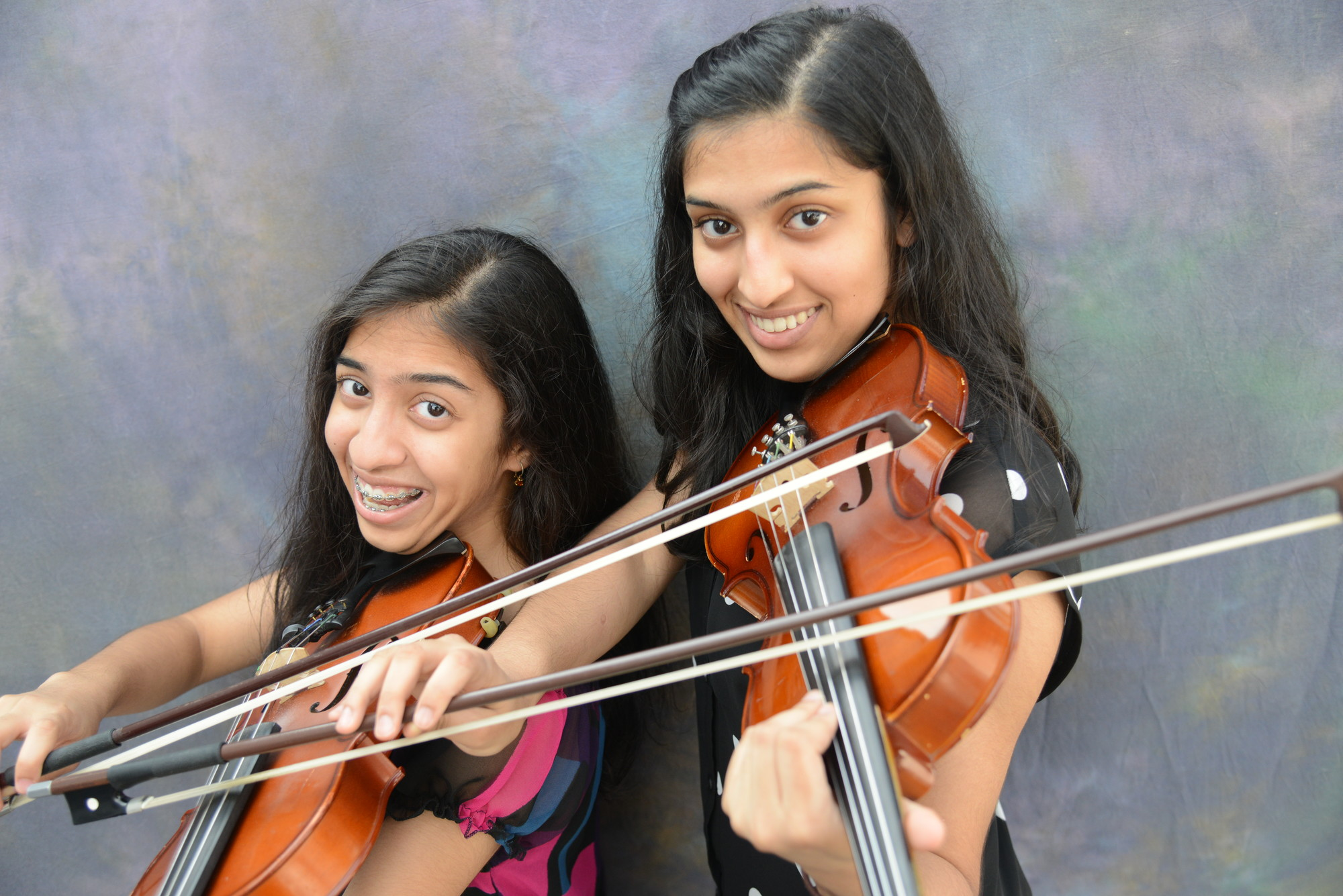 Aashini Shah, 13, and sister Binita, 17, of Salisbury, are more than just violinists.