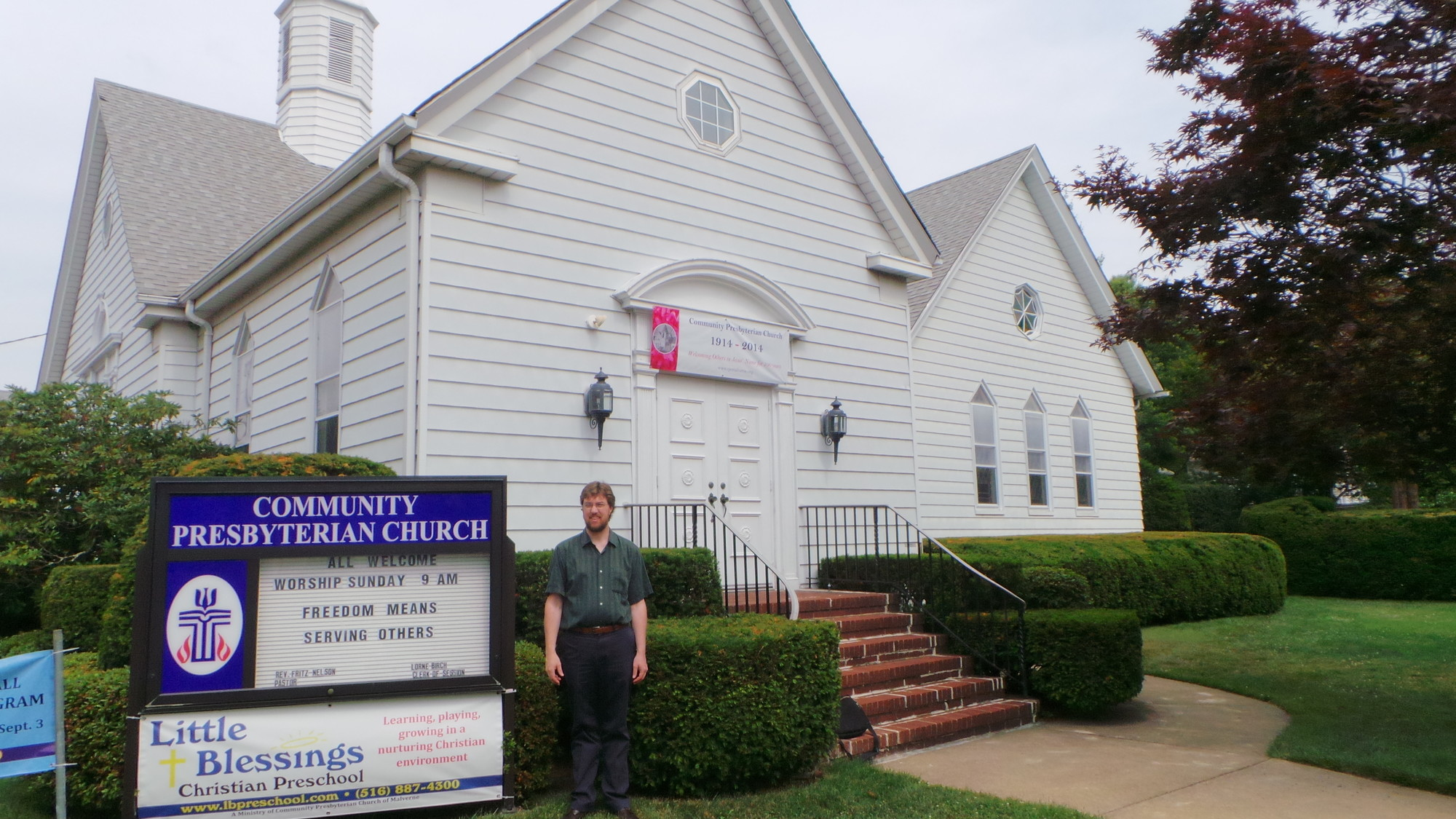 Pastor Fritz Nelson outside the Community Presbyterian Church of Malverne