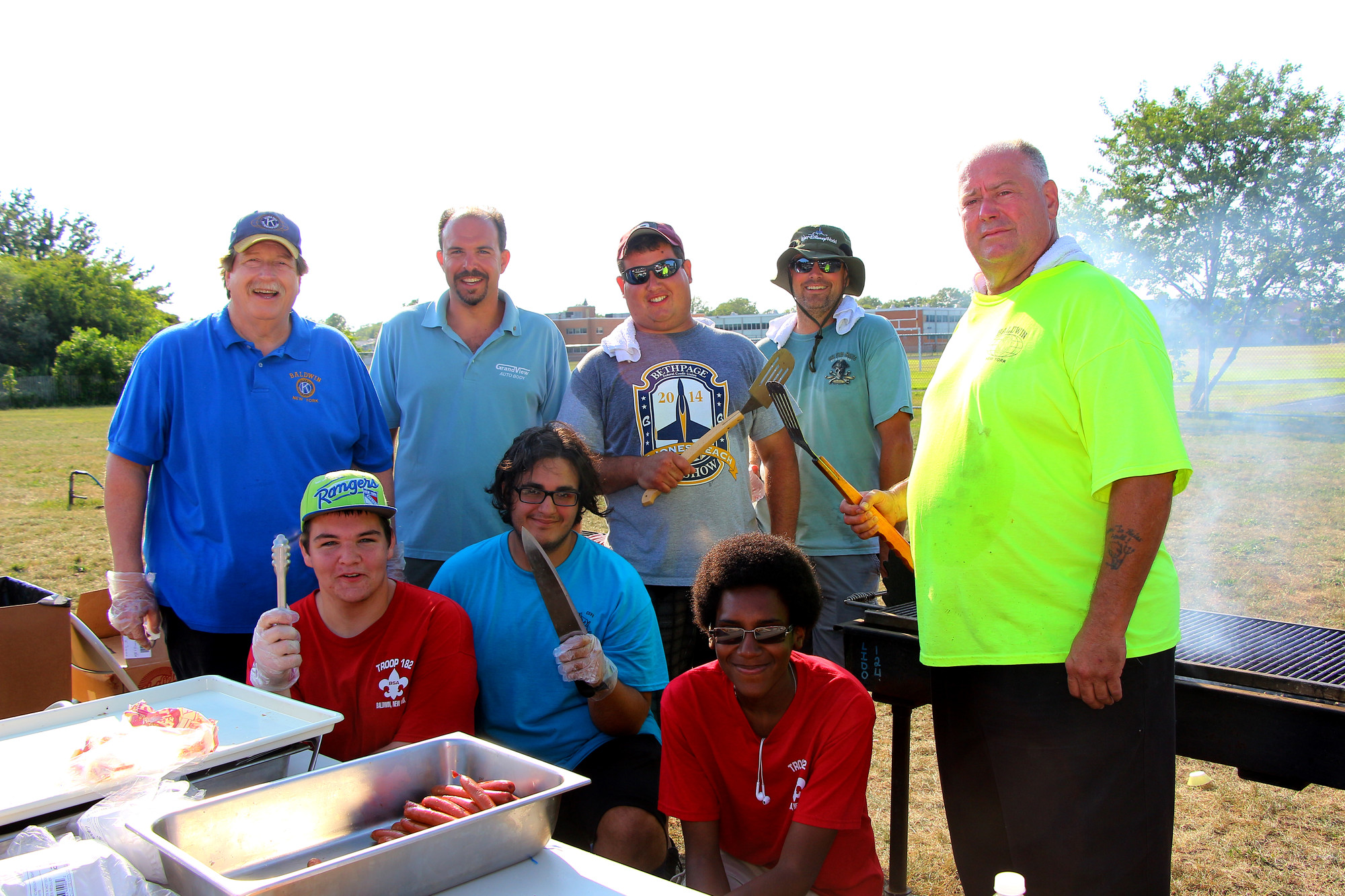 Volunteers served up more than 1,800 hot dogs and hamburgers during the Baldwin Chamber of Commerce Picnic in Baldwin Park. Back row from left were Tony Tarantino, Paul Lizio, Peter Ortiz, Bret Rose and Ralph Rose. From row from left were Brandon Louis, Gabriel Turnan and Kevin Meyers.