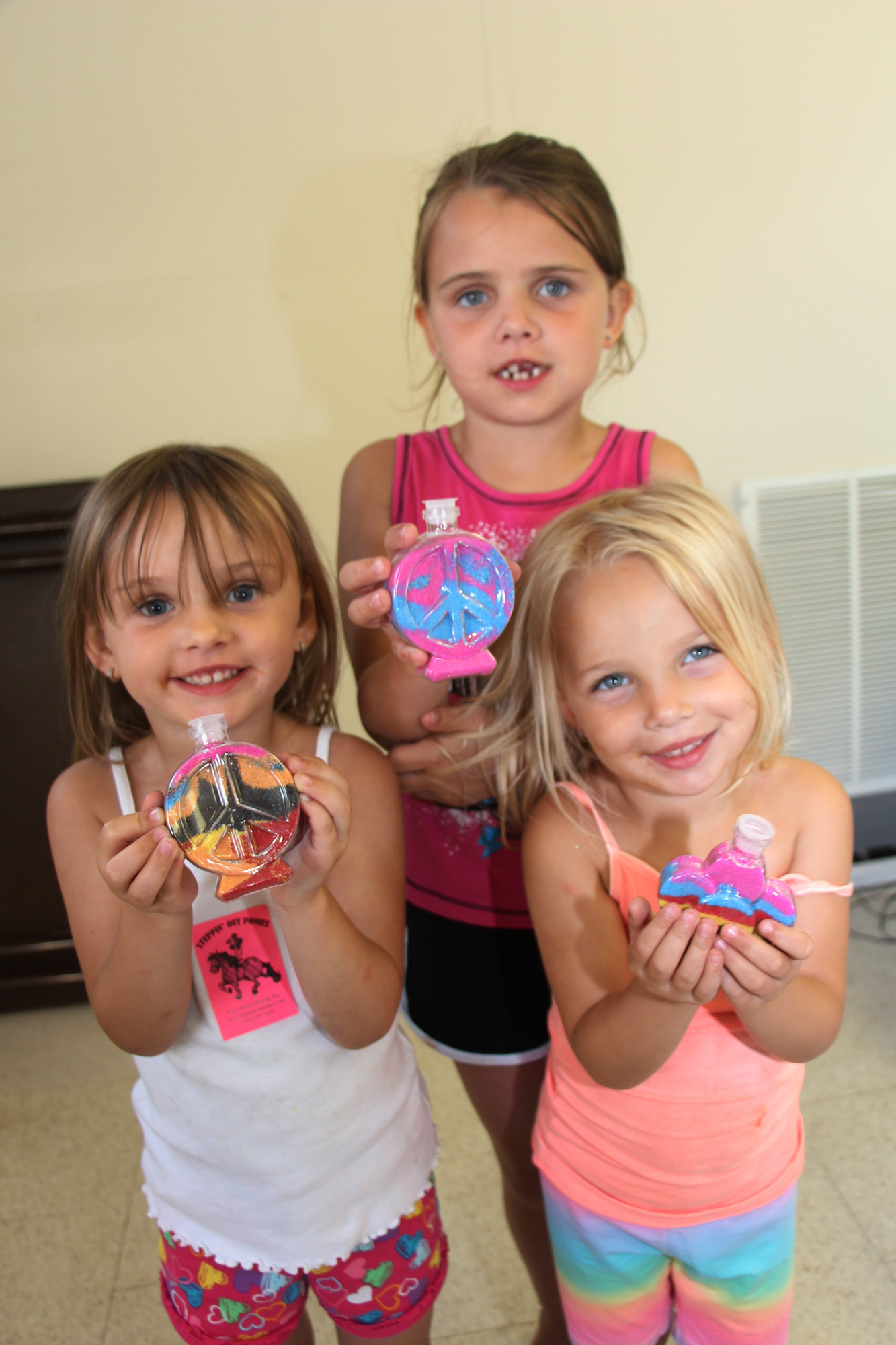 The Frantzen sisters had some fun making Sand art. Jaclyn, 3, left, Kylie, 3, right and Makayla, 6, showed off their work.