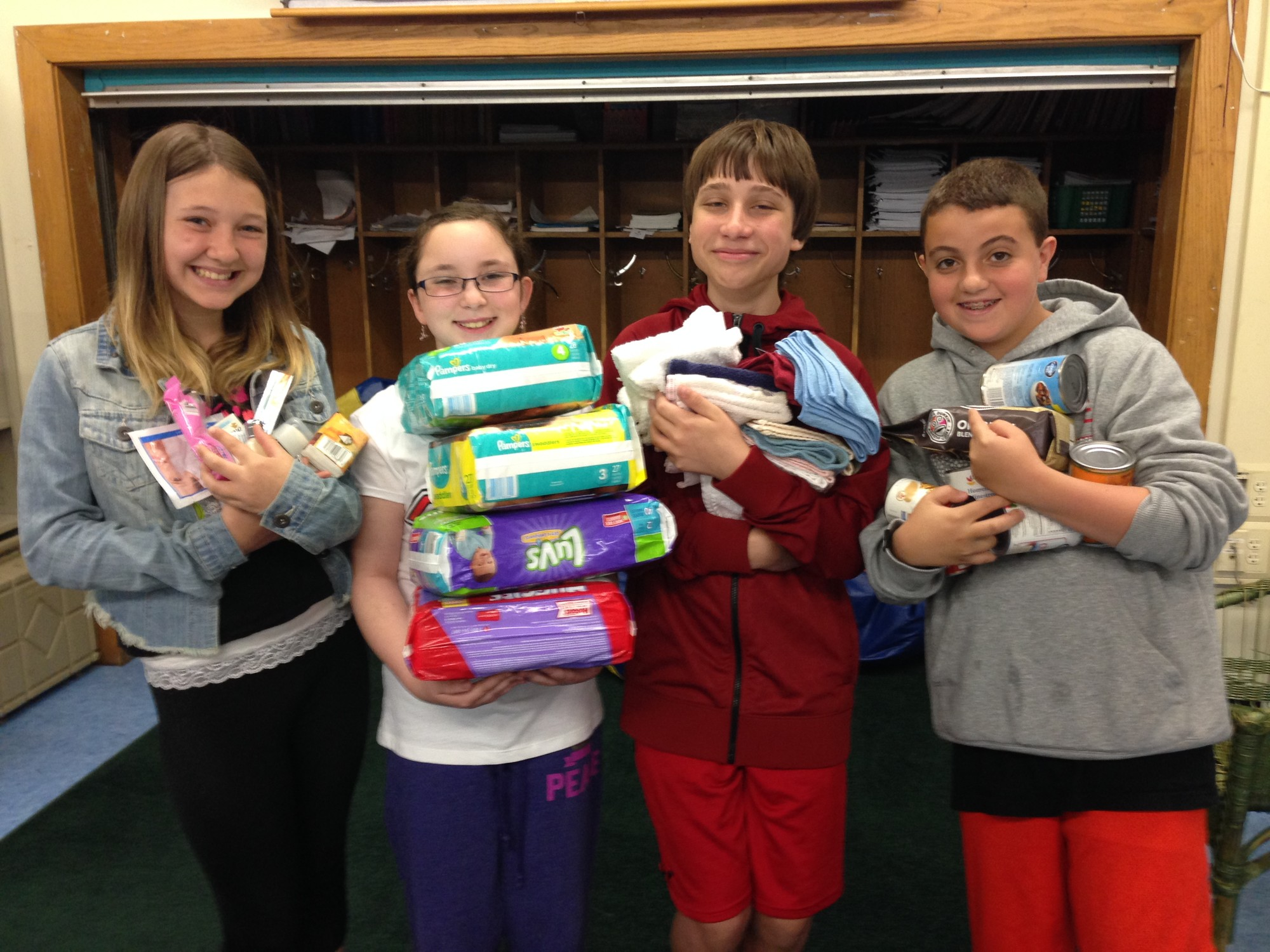 Emma Padula, Lillian Stone, Connor Desmond and Andrew Heffez, from left, contributed to the collection for the Interfaith Nutrition Network.