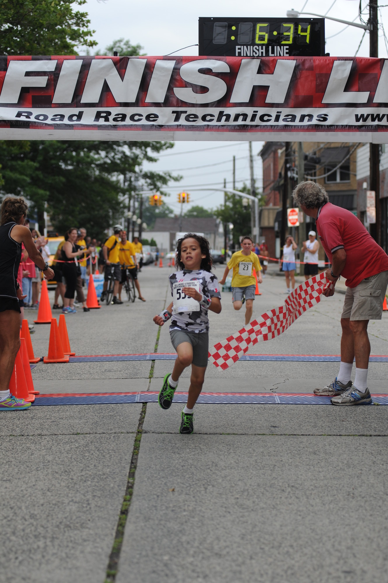 Isayah Contreras, an 8-year-old from North Bellmore, won the one-mile race for children.