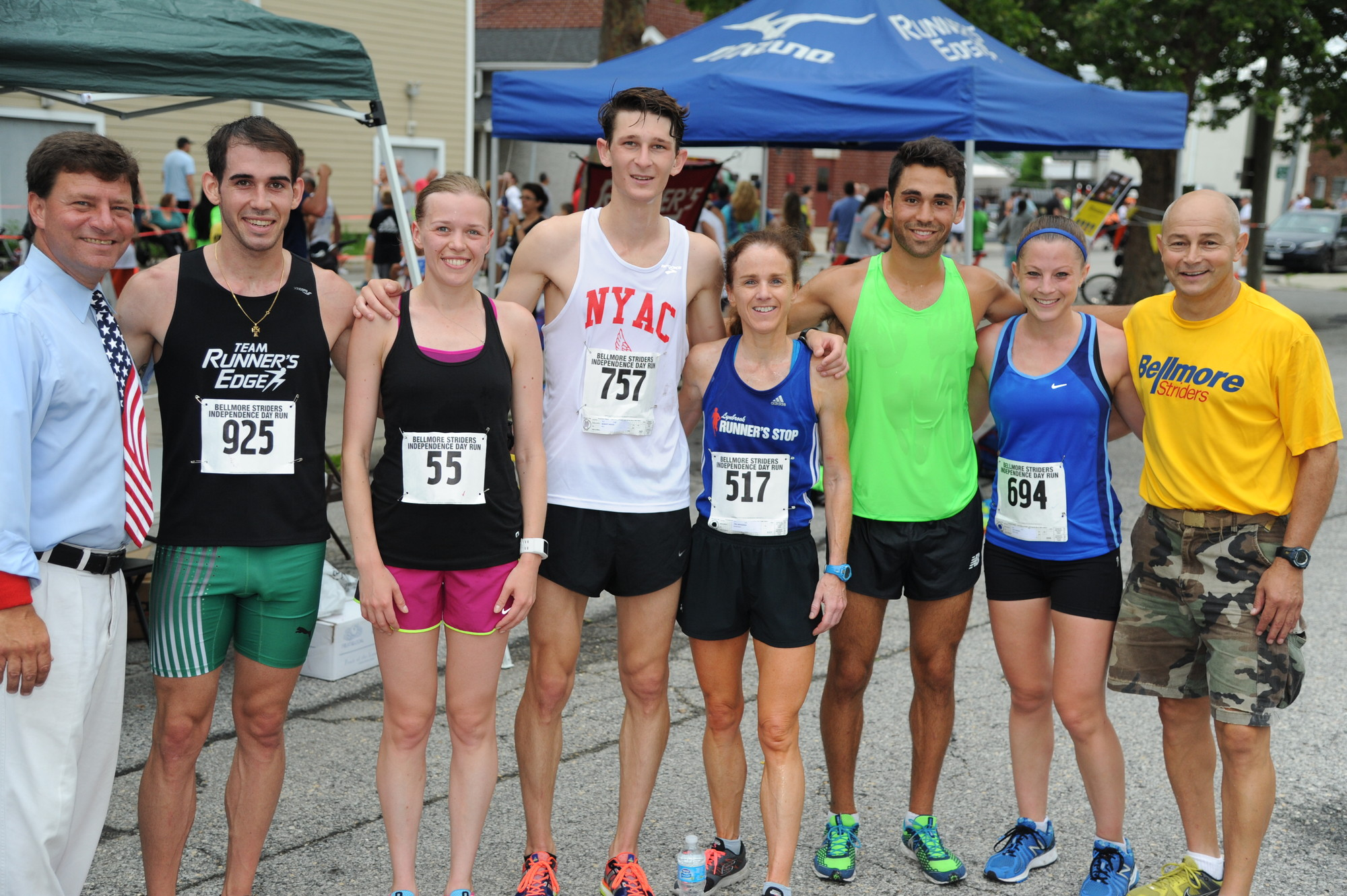 Nassau County Legislator Dave Denenberg and Bellmore Striders President Alex Cuozzo, far right, posed with the top runners, from left, third-place finisher Andrew Coelho, first-place women's finisher Victoria Kornieva, first-place finisher Robert Molke, third-place women's finisher Una Broderick, second-place finisher Julian Saad and second-place women's finisher Jacy Kruzel.