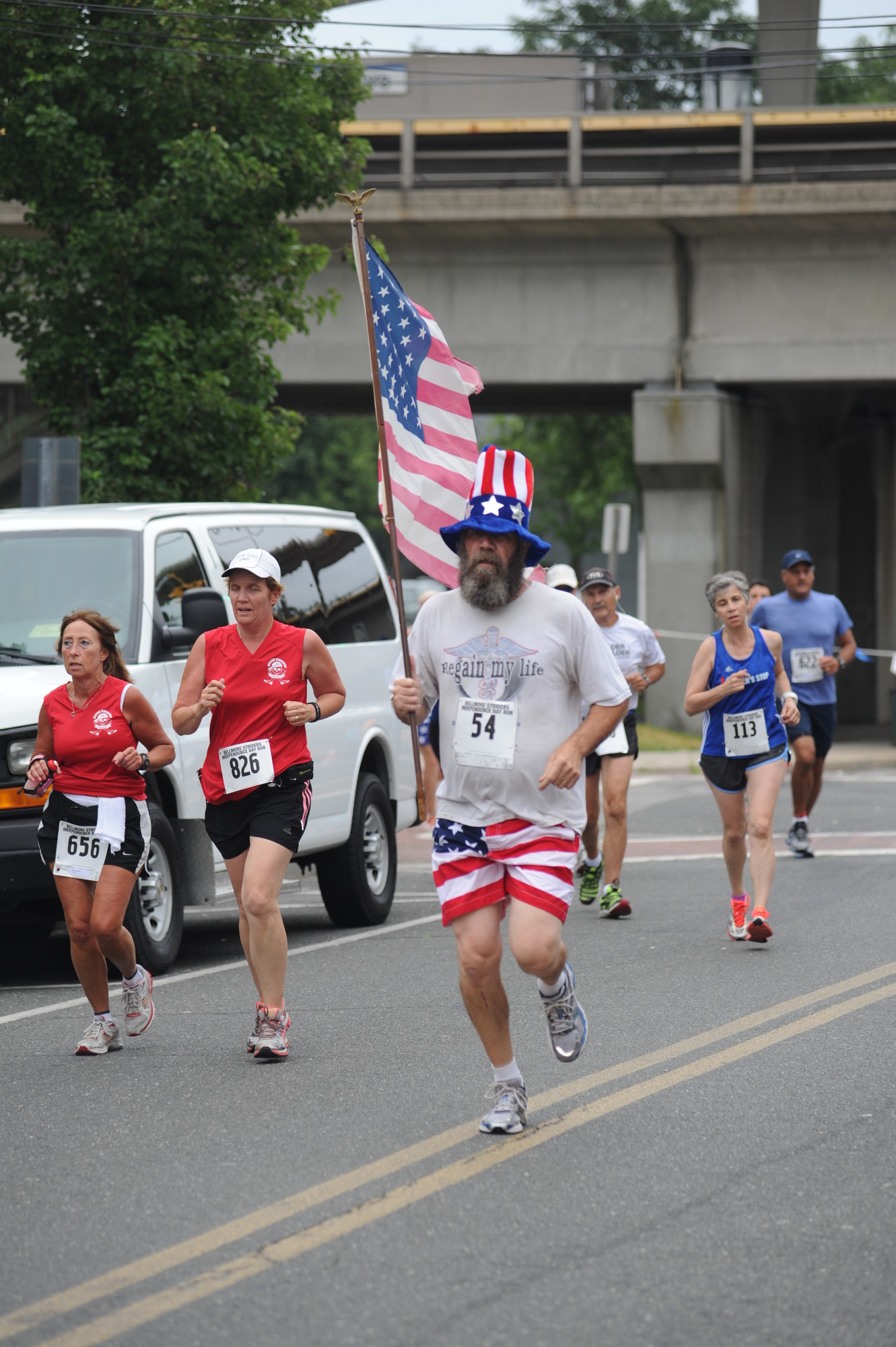 John Skidmore, of North Bellmore, raced through downtown Bellmore in patriotic fashion.