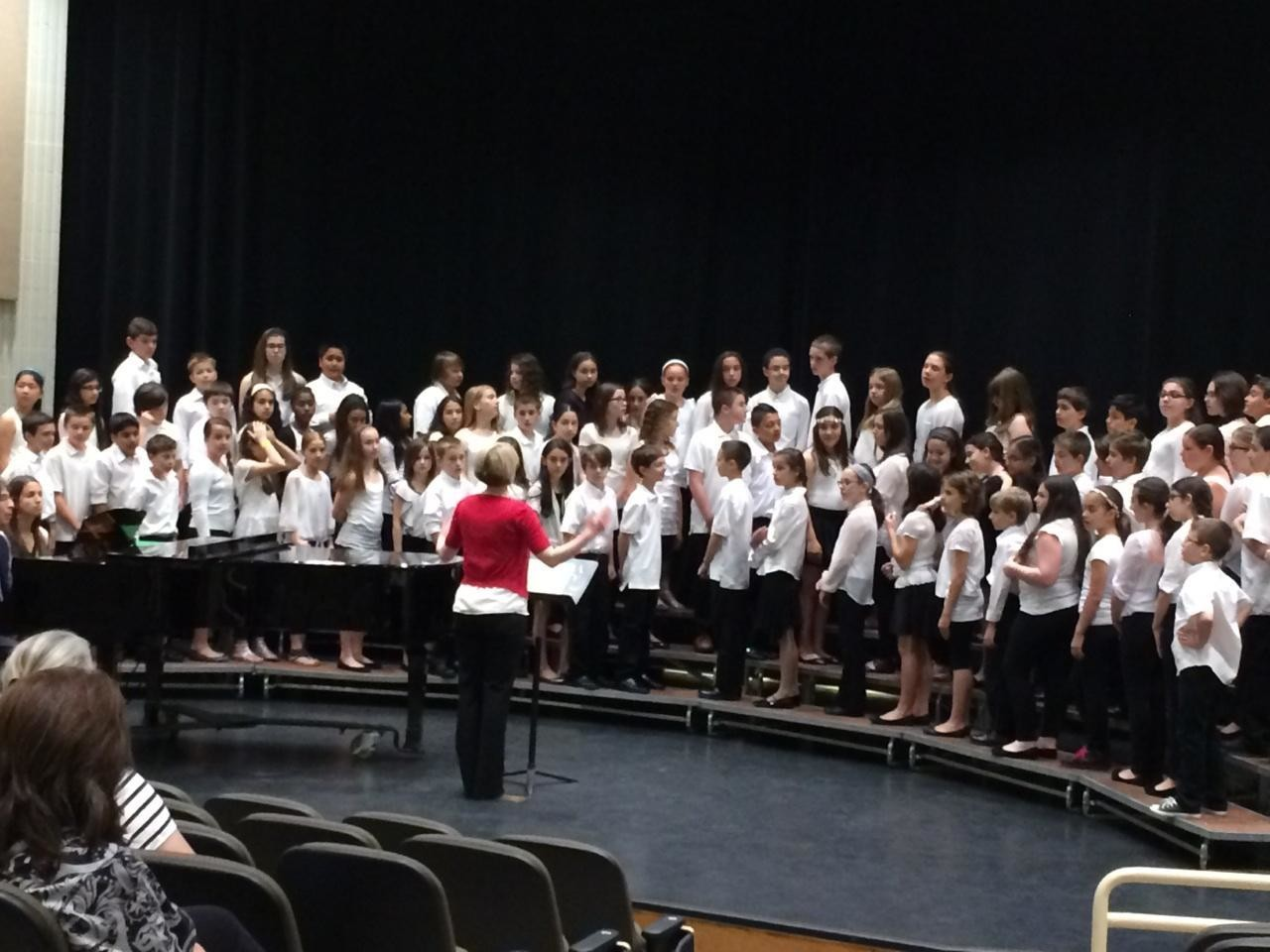 Emilie D'Andrilli conducted Dinkelmeyer's fifth- and sixth-grade chorus, which received a silver medal at the festival.