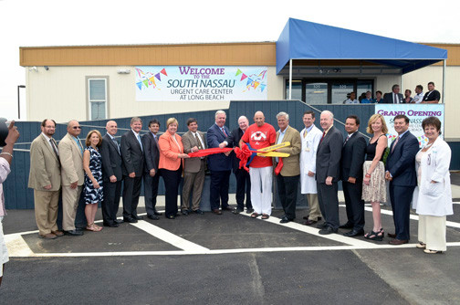 South nassau communities hospital officials were joined by local and state officials at a ribbon-cutting ceremony on July 10 to mark the grand opening of SNCH's urgent-care center.