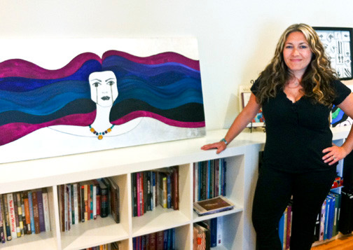 "Mia Barkan Clarke, a Merrick resident and artist, in her studio with the piece entitled ""Freya Flowing Bifrost."""