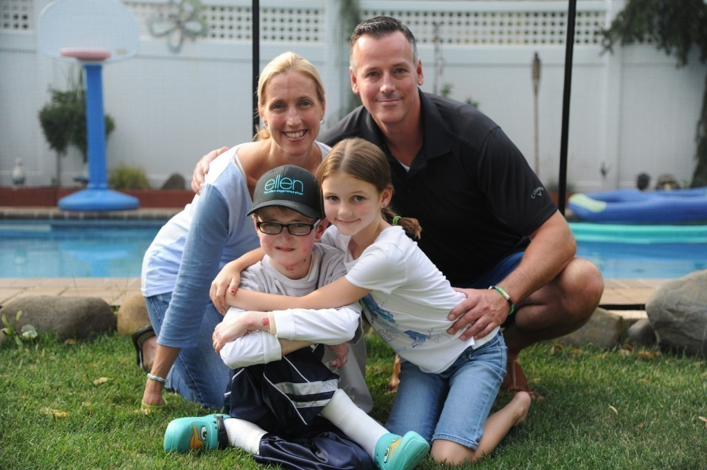 Kathy and Robert Twible, with their children Robbie, 12, and Allison, 7, in the backyard of their East Meadow home.