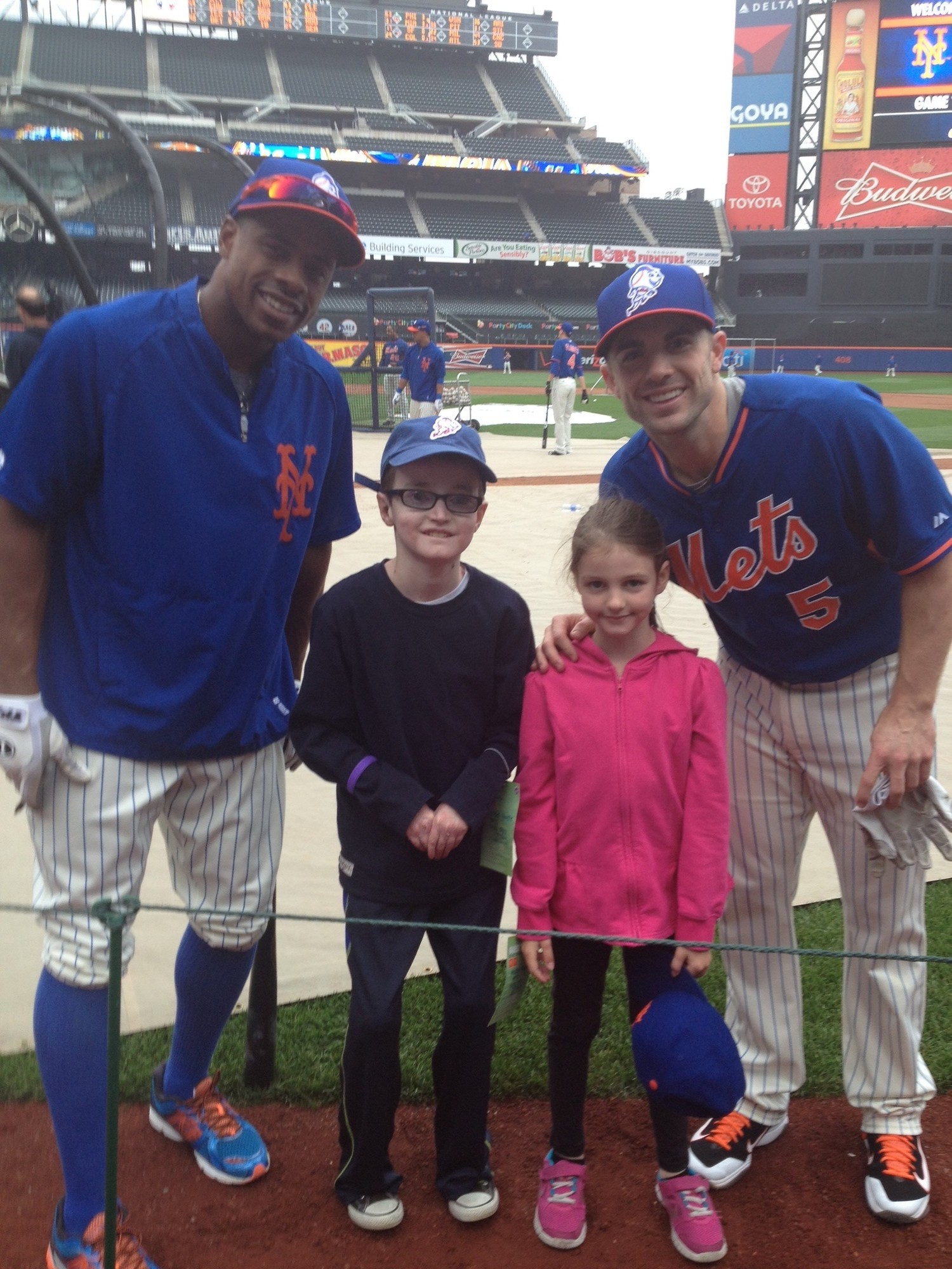 Robbie met New York Mets players David Wright and Curtis Granderson at Citi Field in May.