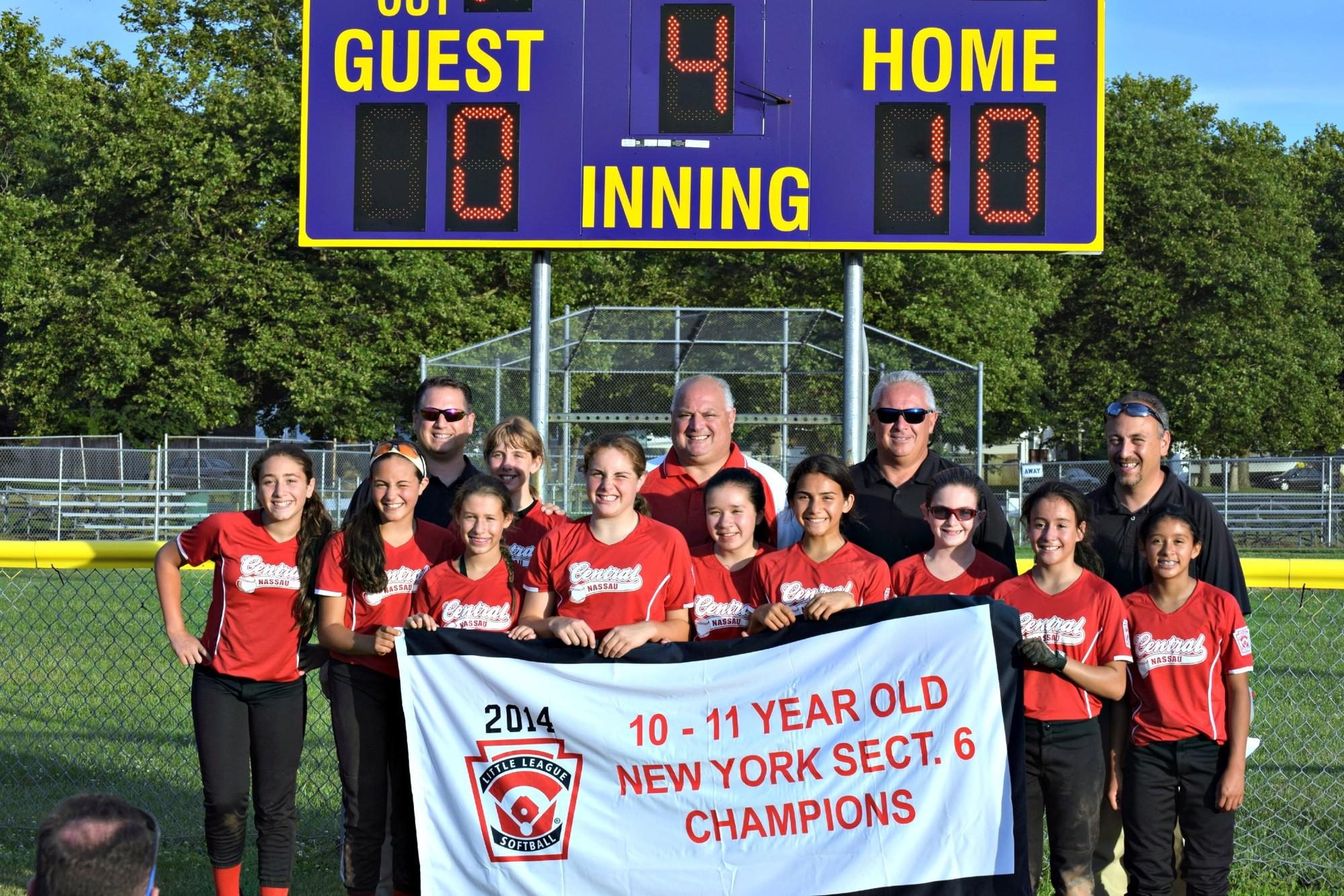 The sectional champion U-11 softball team from the Central Nassau Little League. In front, from left, is Fallon Panzarella, Gab Sferrazza, Toni Ann Servider, Juliana Aloi, Kira Gruber, Mia Biscardi, Kayla Connolly, Brittney Cardona and Sandy Wortman. In back, from left, are Bill Karavias, Alex Karavias, Joe Aloi, Ray Connolly and Sal Sferrazza.