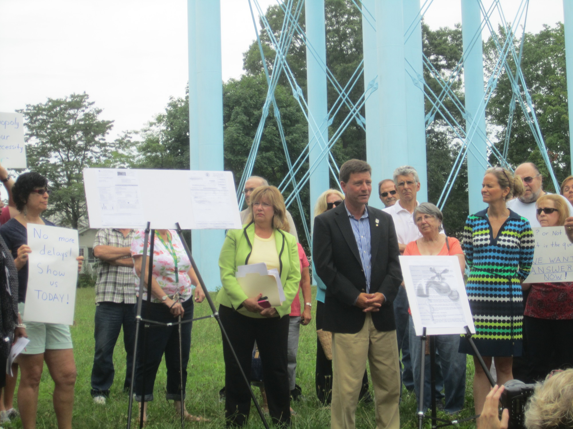Nassau County Legislator Dave Denenberg, fourth from right, front, led a July 16 protest at the Merrick water tower to call for the release of a draft study of a proposed public takeover of Long Island American Water. To Denenberg's left was County Legislator Laura Curran. About 30 local residents joined them.
