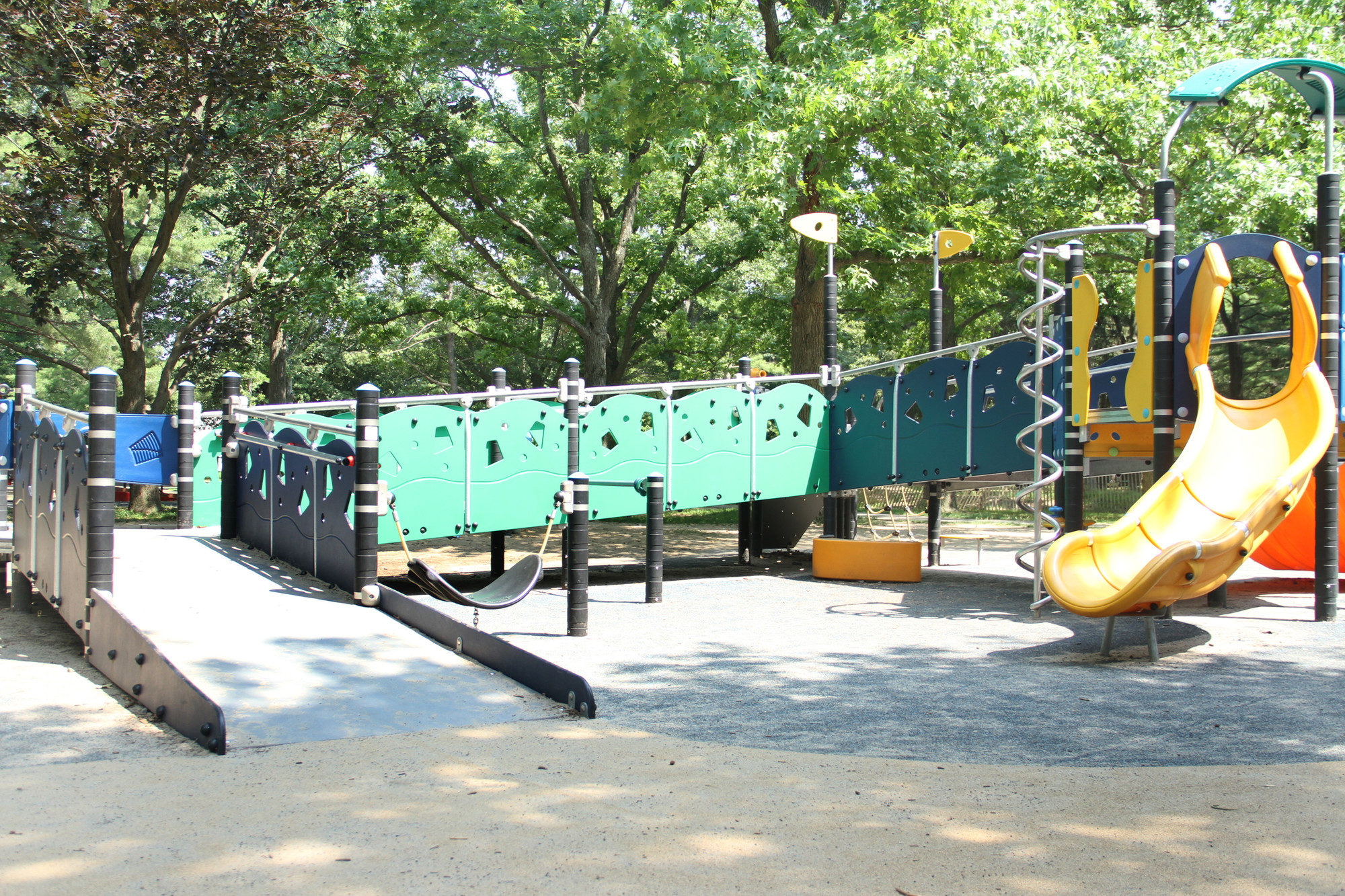 The playground features customized equipment that accommodates children who have special needs.