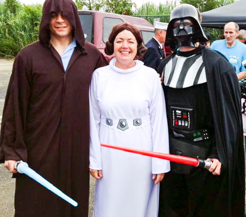 "MaryKate Lynch, center, with Adam Harrison, left, and Josh Warner said the ""force is with us"" at the playground building event."