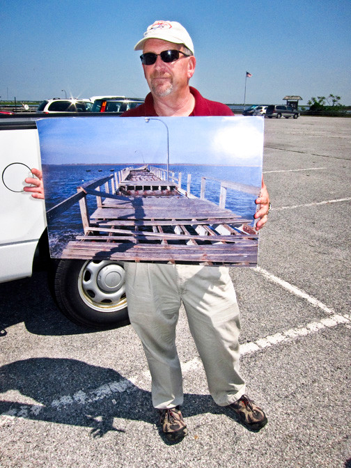 Jones Beach Director of Operations Hank Leggio showed a photo of a bayside pier after Sandy struck.