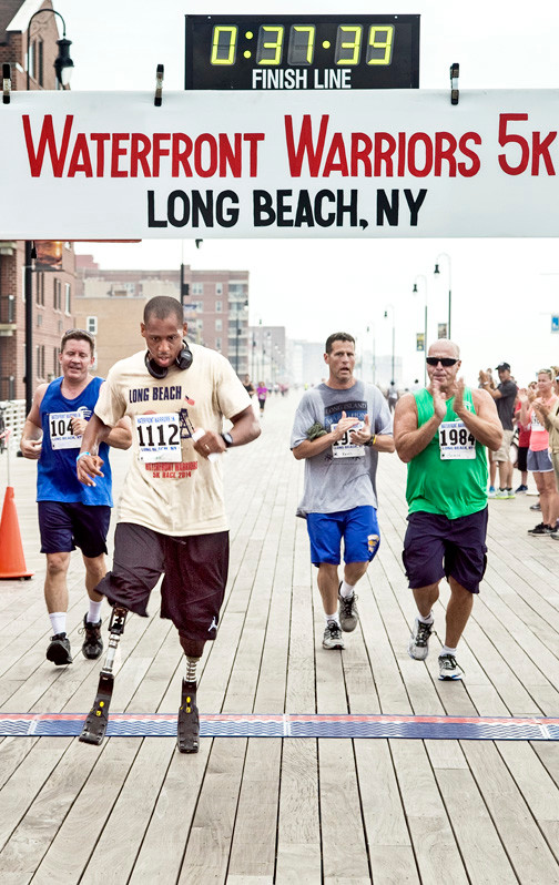 U.S. Marine Corps Master Sgt. Cedric King, at left above, crossed the finish line of last Sunday's annual Waterfront Warriors 5K race.