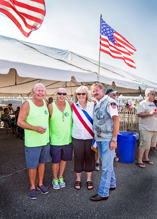 Jerry McParland, left, Long Beach Waterfront Warriors Co-chair Gerry Snell, Legislator Denise Ford, and John Rokee, a NYC firefighter who rode the parade route on his motorcycle with the NYC Fire Riders.