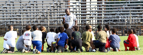 Coach Leonard Tudy talks to the kids.