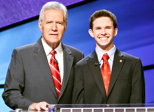 Joe Taglic, of Valley Stream, joined by Jeopardy host Alex Trebek.