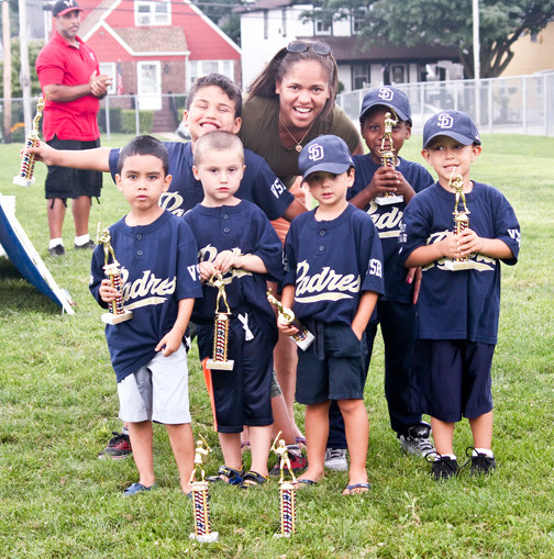 Players from the padres, from left, Junior Rivera, Kenny Valdez, Sean Geed, Chris Christoforidis, Zyler Ramsey and Zenon Eliopoulos were joined by their coach Yudelka Valdez after receiving their trophies last Saturday.