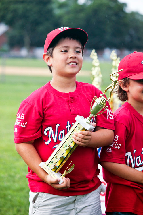 Nathan smith, 7, of the Nationals, admires his trophy.