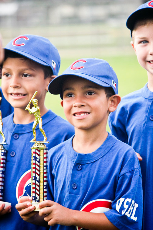 Gabriel Gil, 6, proudly displayed his trophy at the Valley Stream Baseball League's closing ceremonies on July 26 at Firemen's Field.
