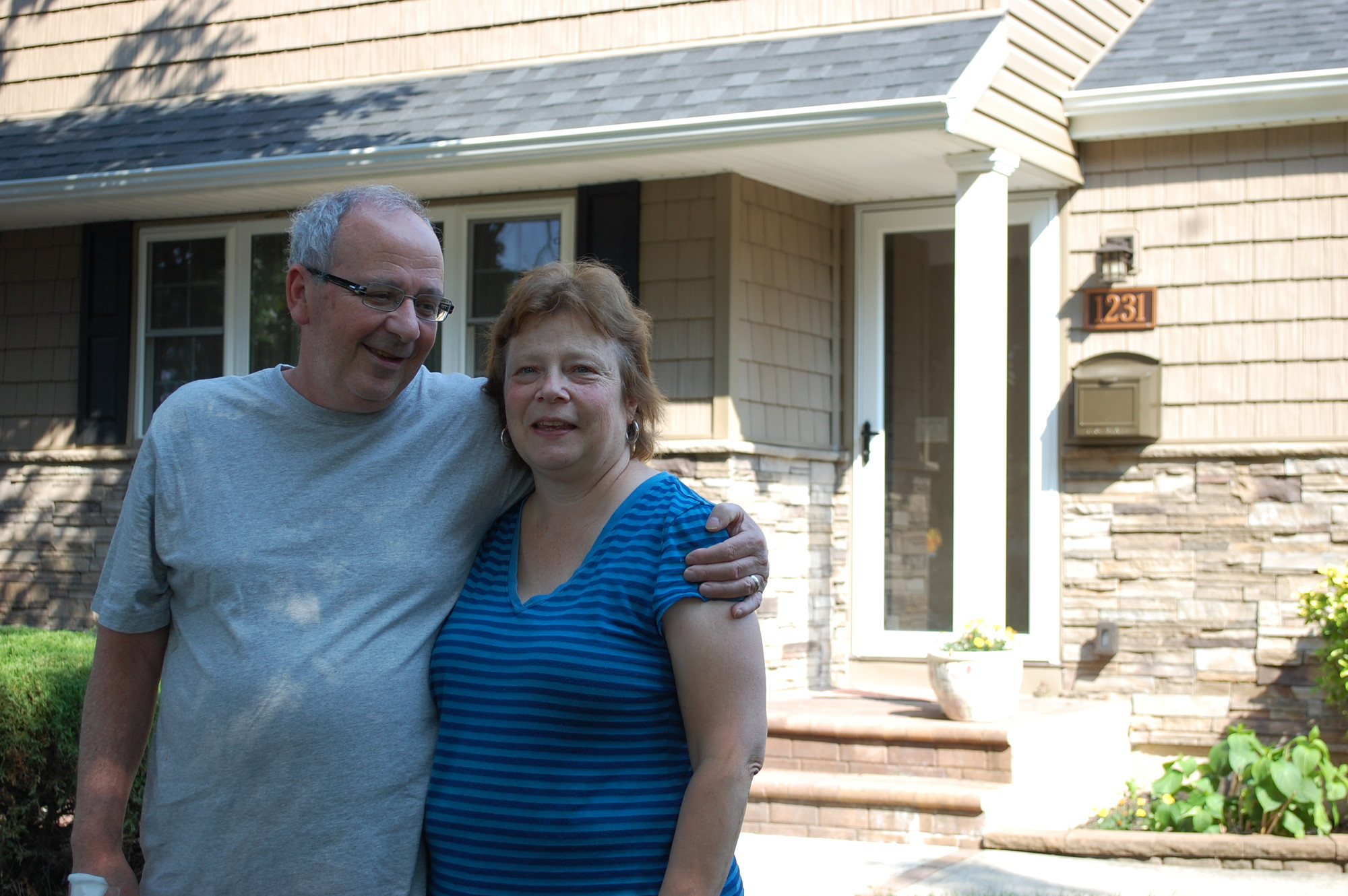 Ed and Jean Garcia, of Wantagh, are happy to be back at their Hawthorne Drive West home after a fire last year.