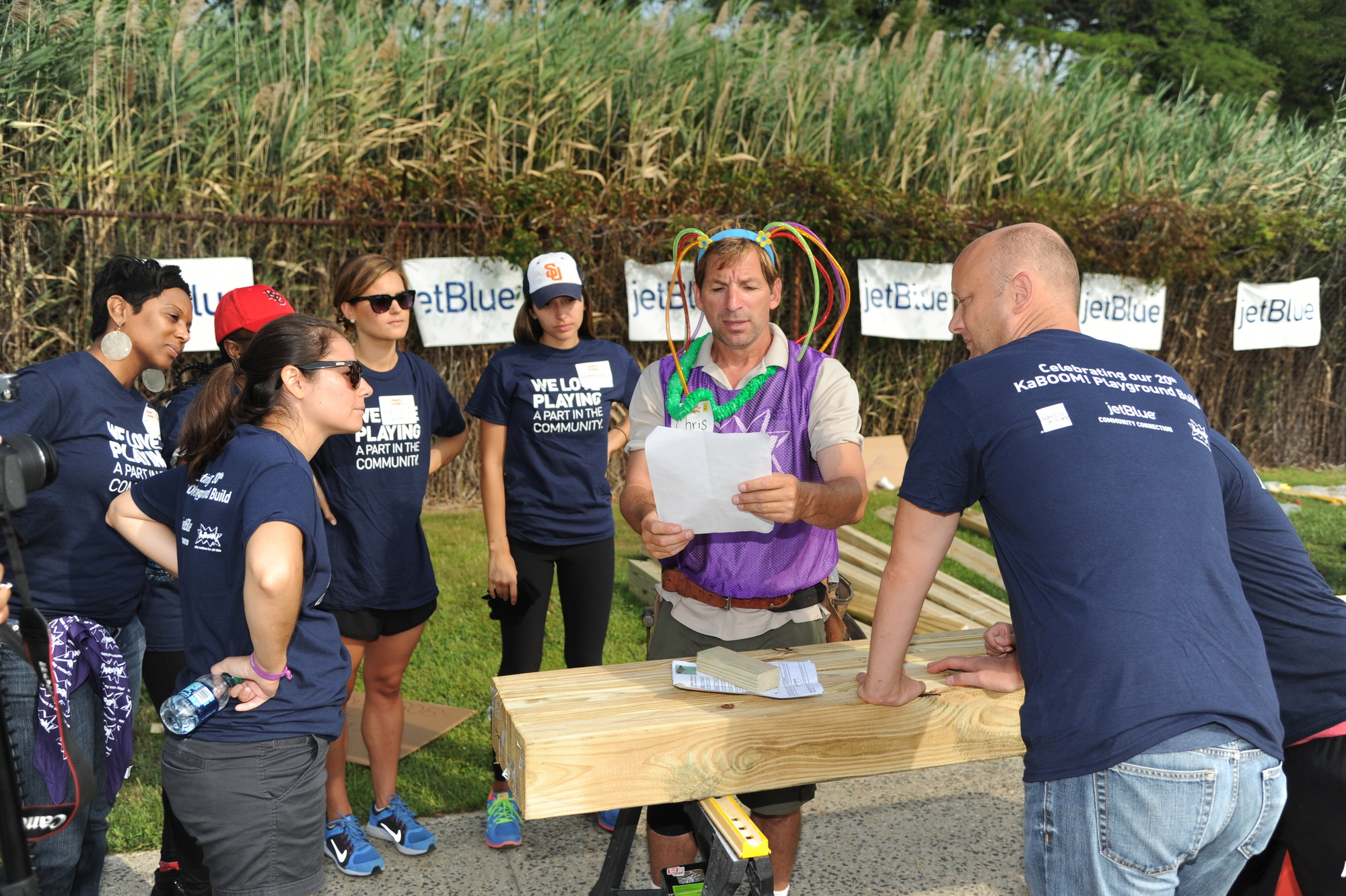 Chris Horvath of Island Park instructed a team of volunteers.