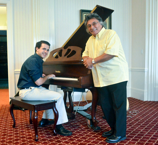Zack Zaromatidis played piano at the event; Al Barbarino is at right.