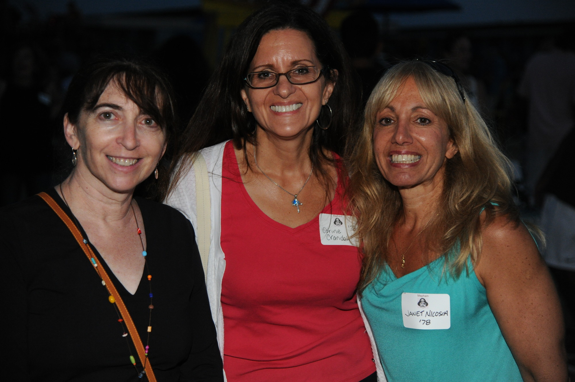 Mindy Passin, Corine Crandall and Janet Nicosia, all of whom graduated from Mepham High School in 1978, showed their Pirate pride at the reunion.