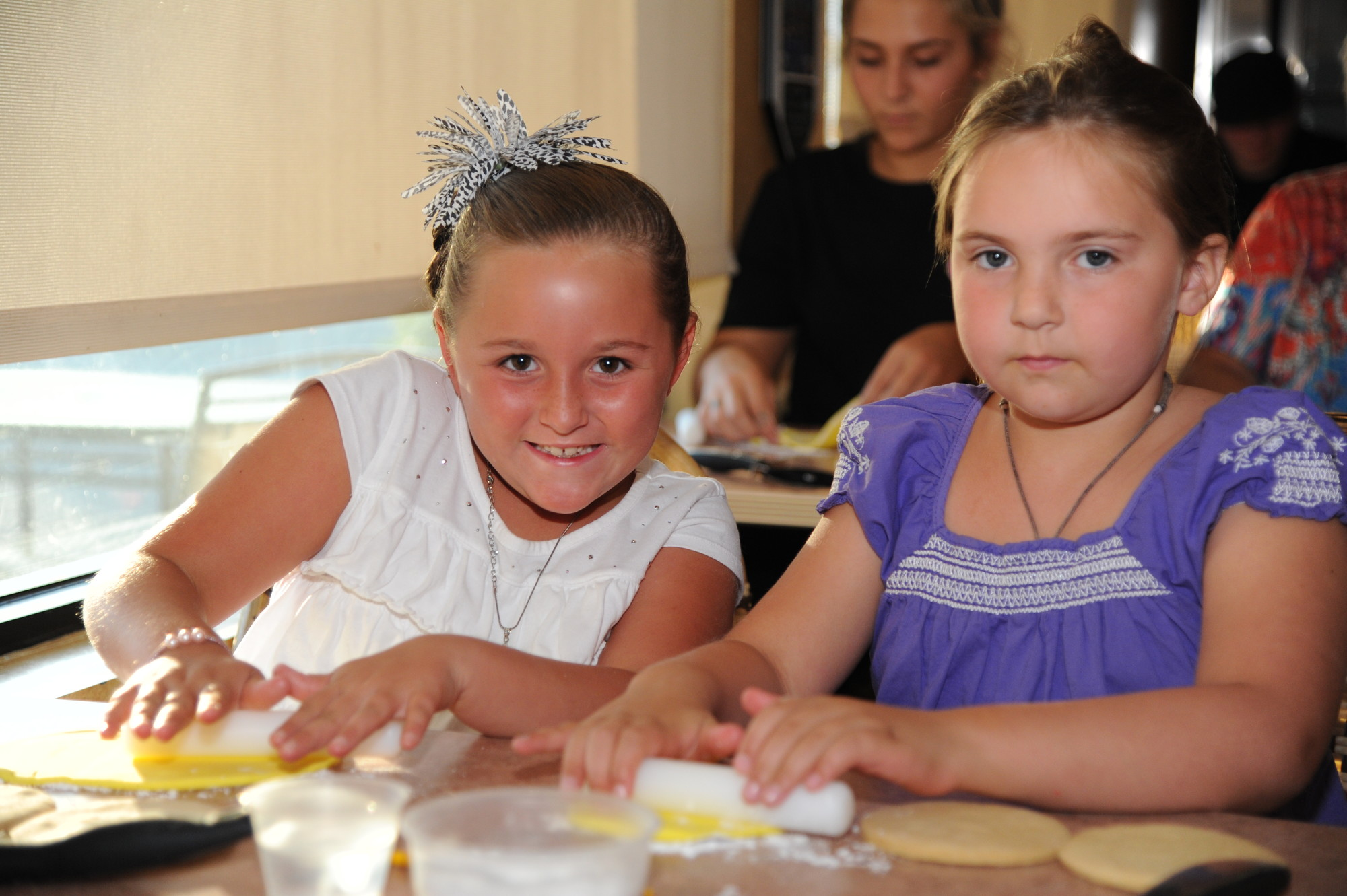 Camryn Wood and Katie Schiller rolled out dough to make cookies at a recent Taste of Home cooking class.