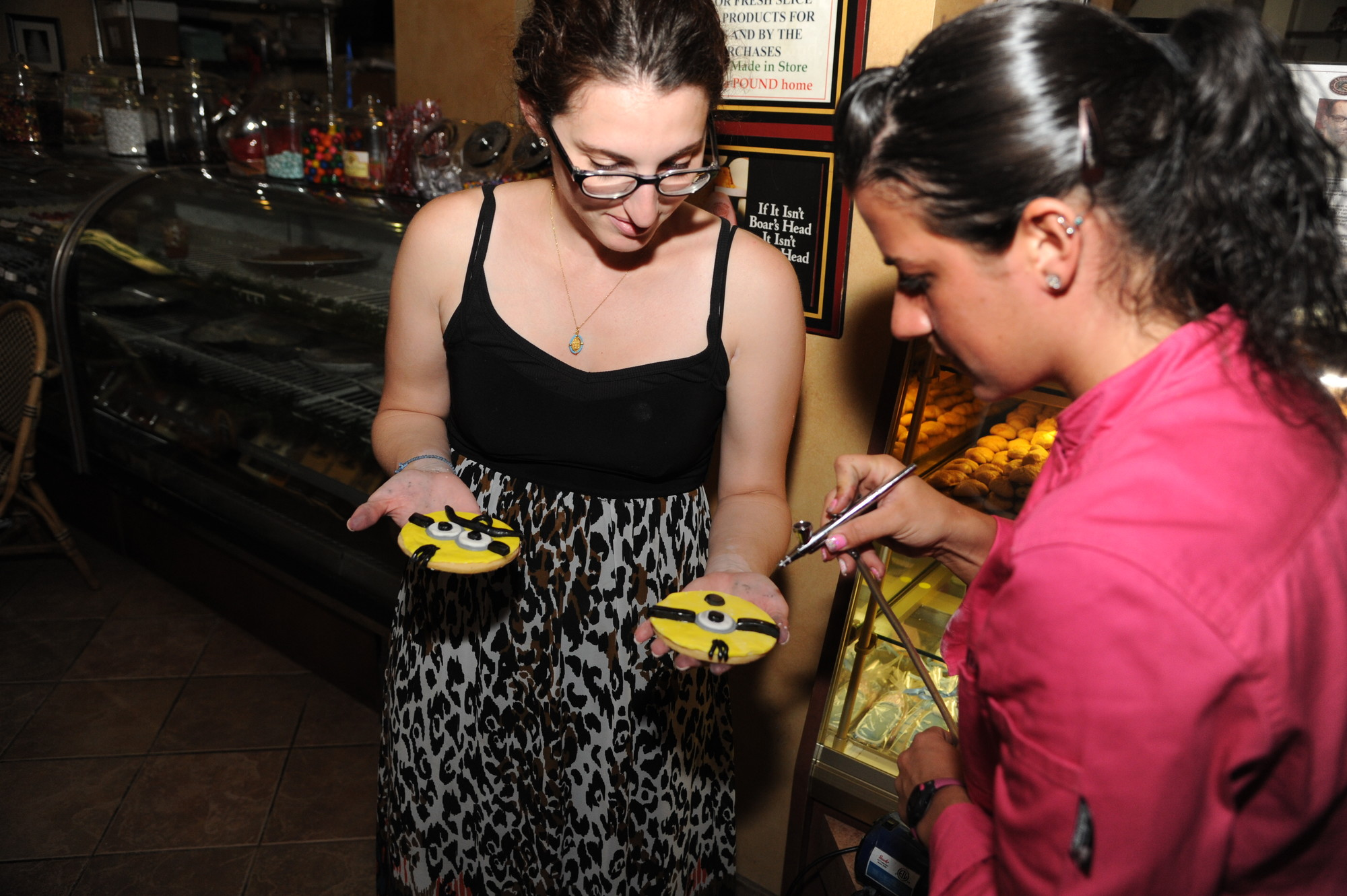 Nadia Vanzan, right, the bakery's executive pastry chef who conducted the class, blew corn starch off Stav Kolitsopoulos's cookies.