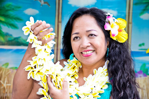 Olivia Manalani performs traditional Hawaiian Hula dance during the yearly luau held at Atria in Lynbrook.