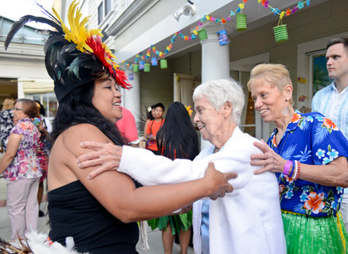 Olivia Manalani taught Caroline and Marge Vesper a traditional hula dance during the event.