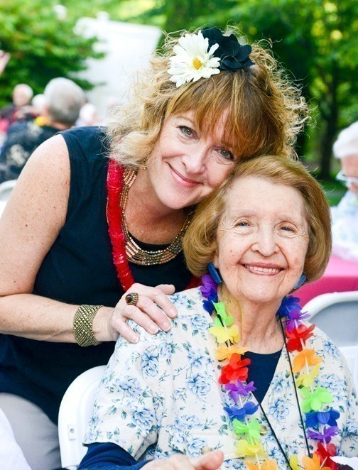 Ellen and  resident Gloria Sherman at the Luau in Lynbrook