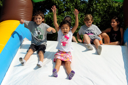 Jacob Rakhimob, Jocelyn Yeung and Gabby Cunha raced down a bouncy slide at a carnival organized by the Merrick School District's summer recreation program on July 31 at Birch School. The carnival was a highlight of a summer, with arts and crafts, sports and enrichment learning for Merrick elementary school children.