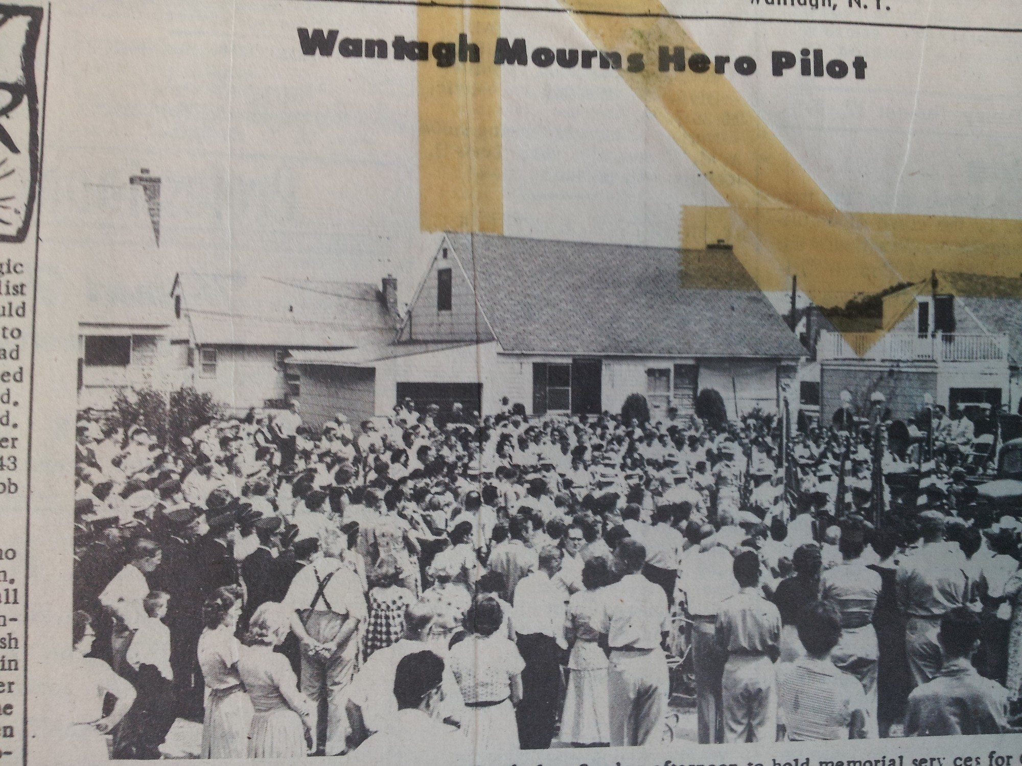 A crowd gathered on Denver Street to mourn the death of the pilot who crashed there in August 1954.