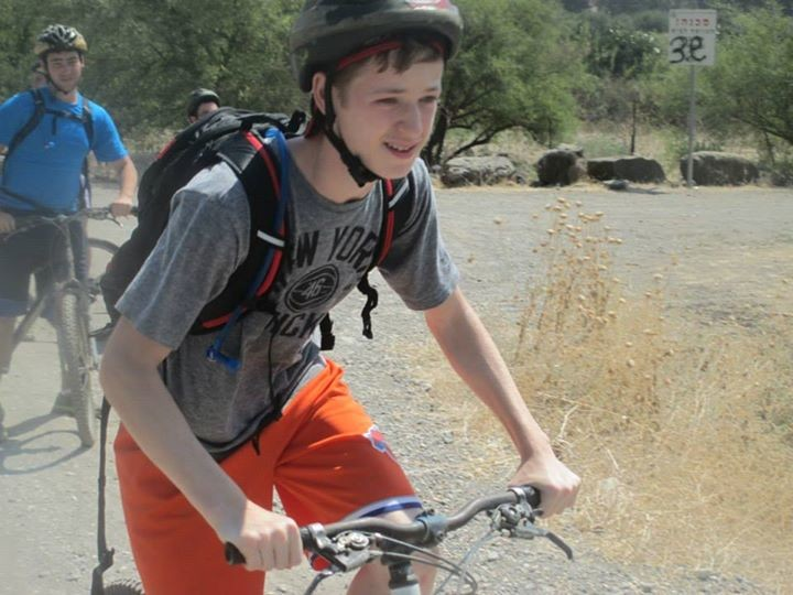 The National Council of Synagogue Youth�s summer program continued in Israel despite the fighting in the Gaza Strip. Woodsburgh resident Jakob Deutsch on a bike ride in the Golan region.