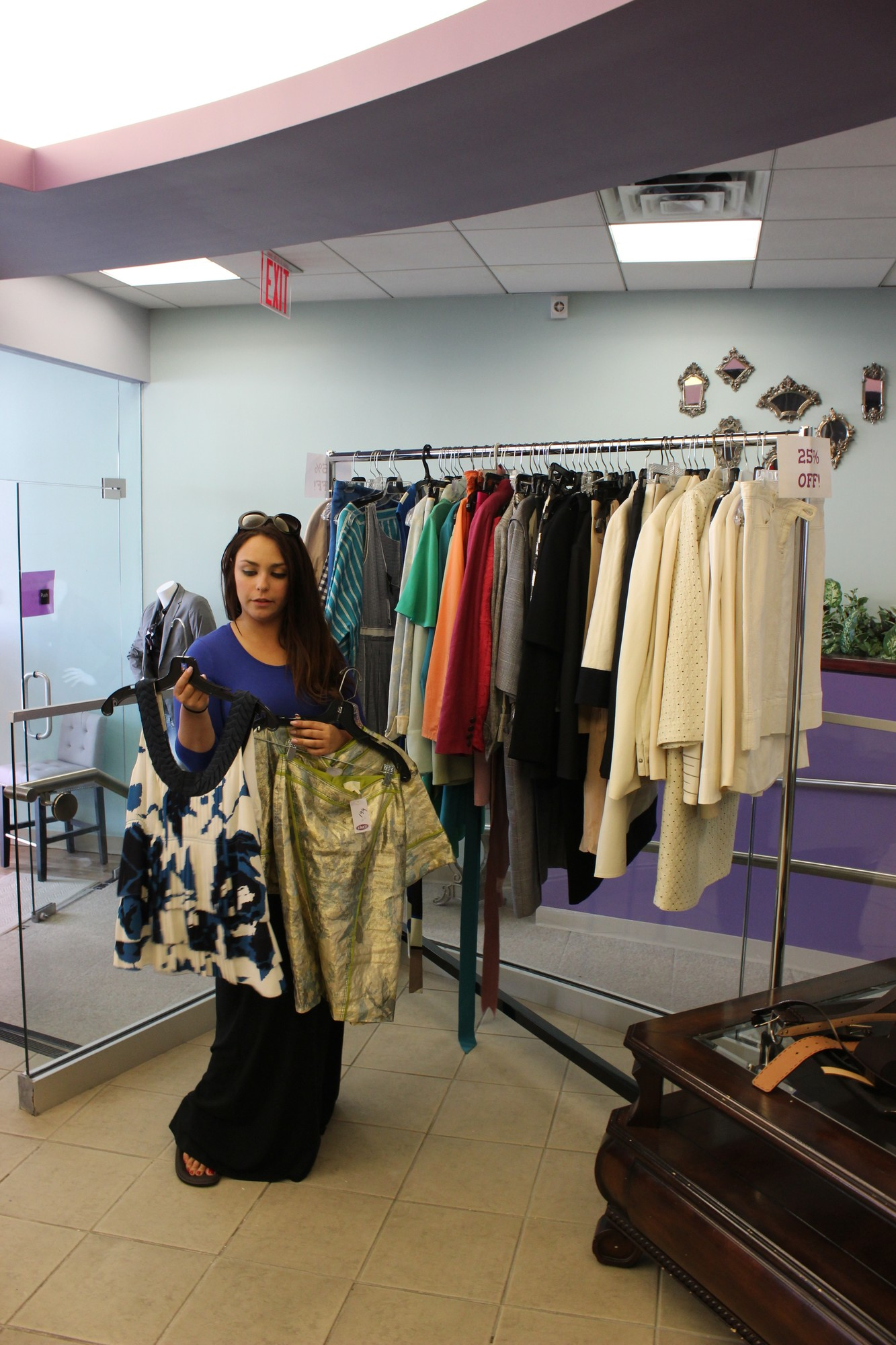 Discounted merchandise was available at more than 80 stores during Cedarhurst's annual summer sidewalk sale. Plum employee Nicole Obshatcko held a blouse and skirt, both marked 25 percent off the regular price.