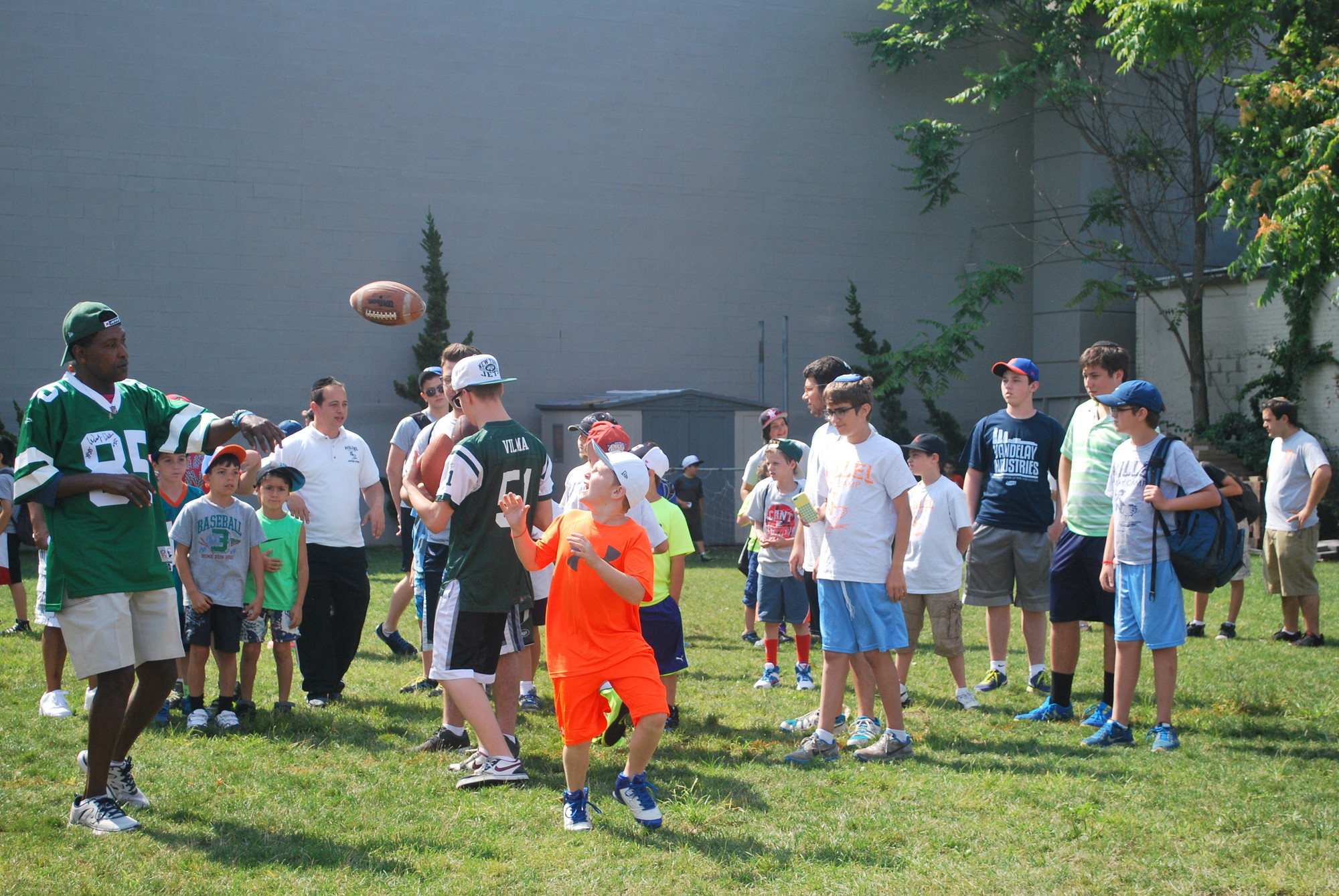 Former Jets receiver Wesley Walker put his quarterbacking skills to use and threw footballs to Camp Hillel campers such as Andy Mordowitz, 8.