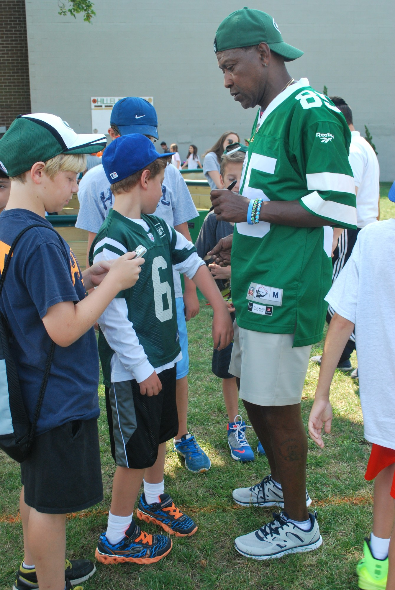 Camp Hillel in Lawrence hosted former New York Jets wide receiver Wesley Walker on Aug. 8, and he signed his name to shirts, hats and football helmets.