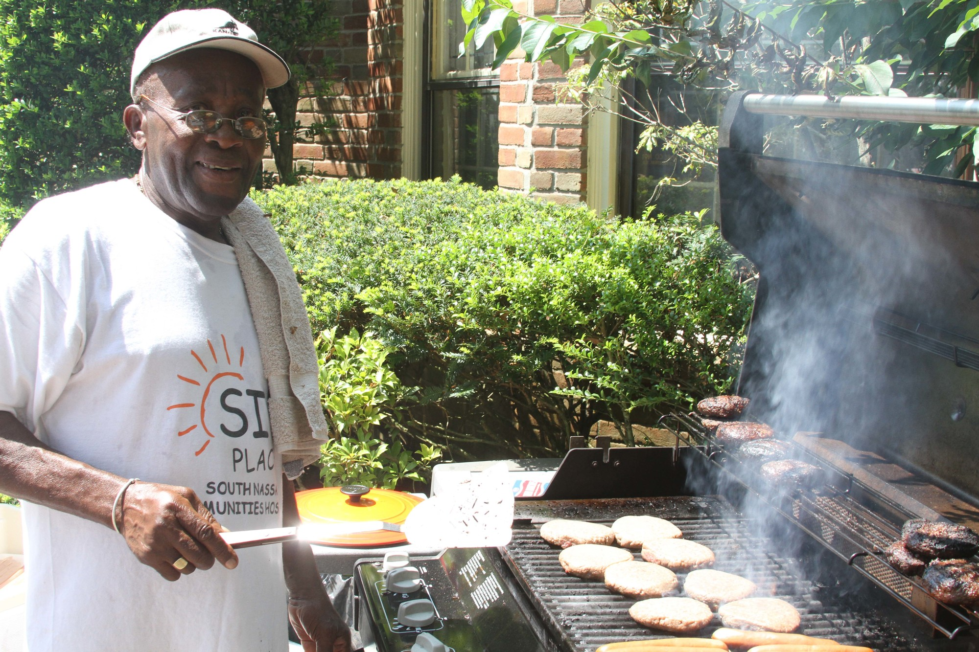 Cyrif Melville served as the day�s chef and grilled plenty of hamburgers and hot dogs for everyone.