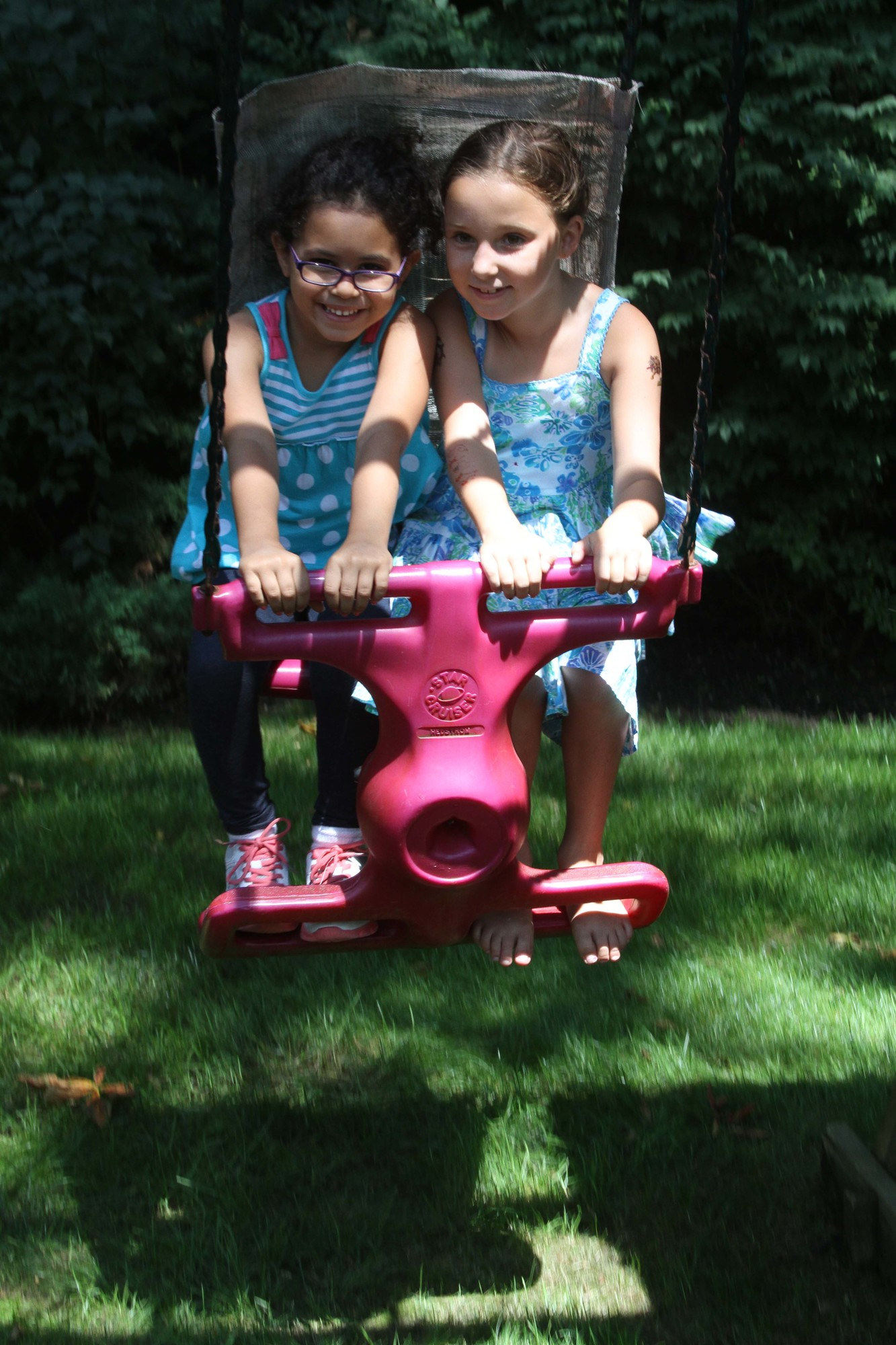 SIBSPlace annual barbecue included several attractions and activities to keep children busy. Above, Angelina Reyes and Annika Margolies, both 7, shared a ride.