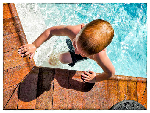 "East Rockaway resident Kathy Leistner's photo ""Boy in Pool"" is among the 150 works on view in ""Endless Summers: Visions of Long Island."""