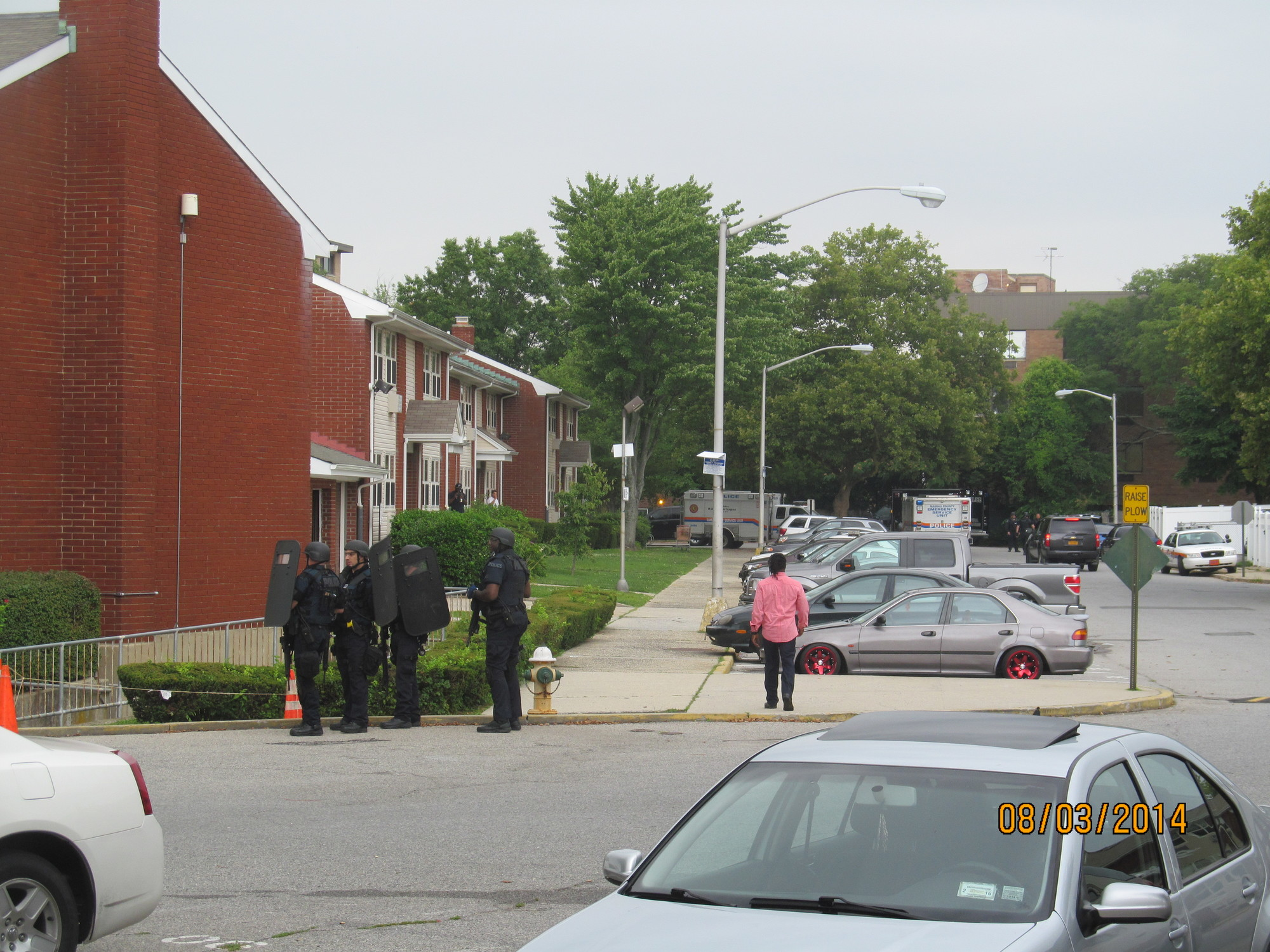 NCPD SWAT officers outside of the Old Mill Court complex last week.