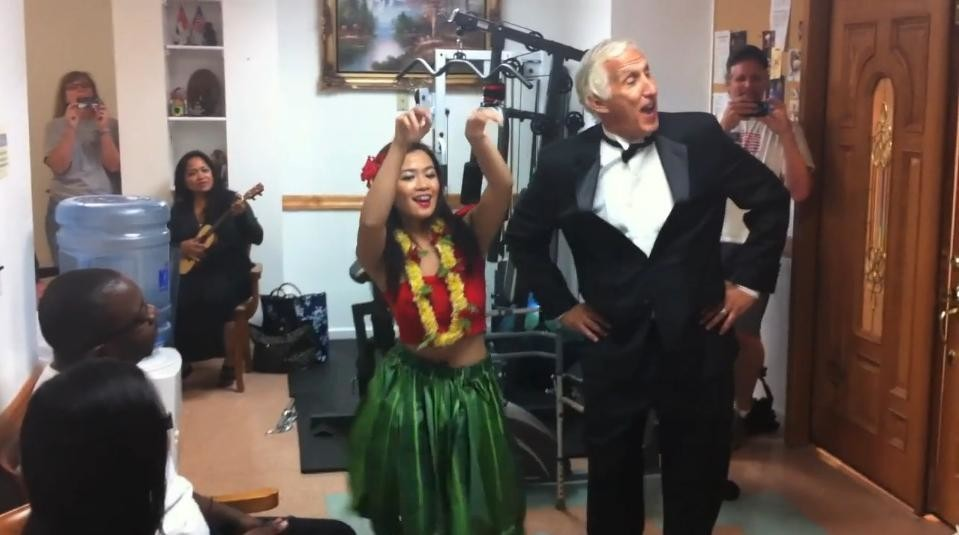 Frank Scafuri performs with a hula dancer at a Freeport doctor's office.