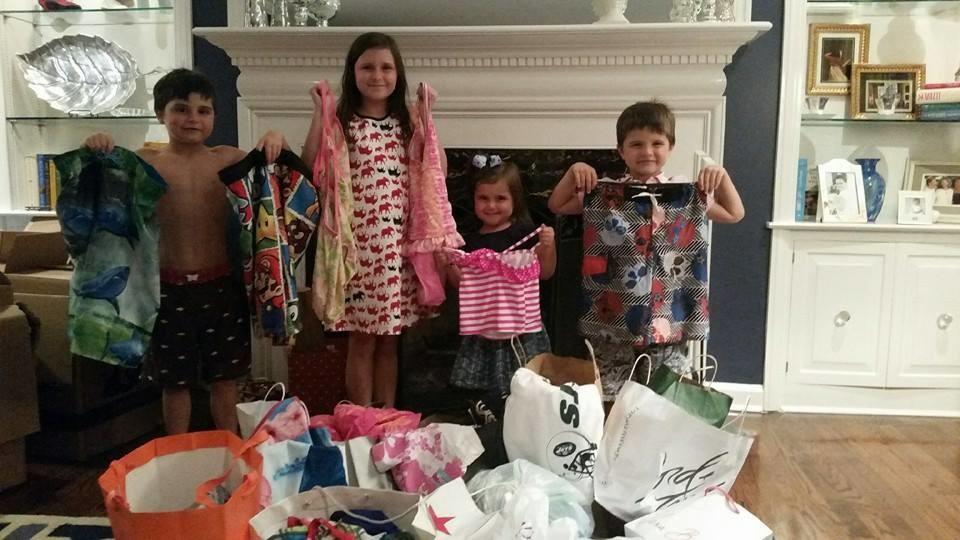 Peter, left, Scarlett, Delilah and Thomas Agresta presented their donations.