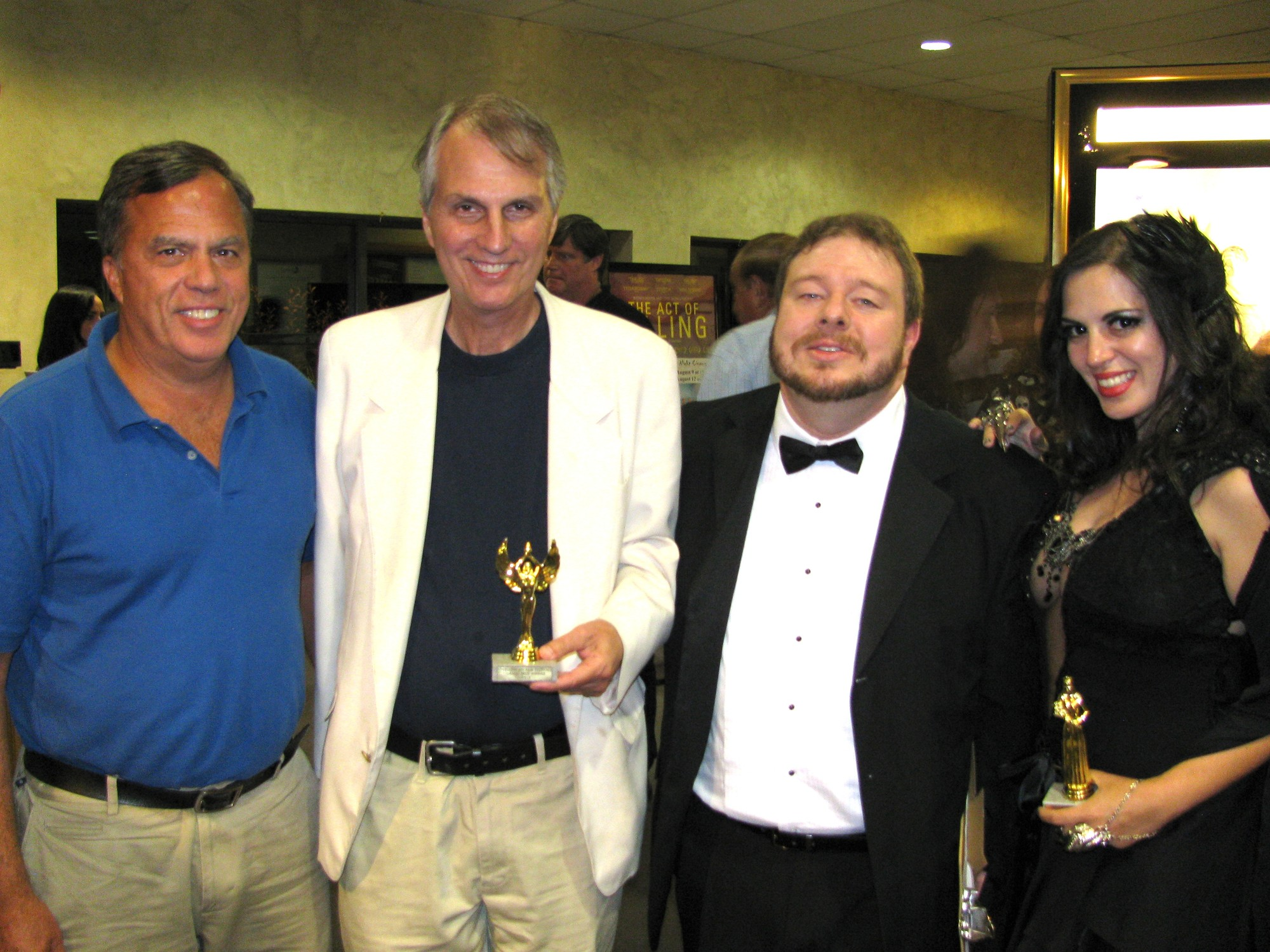 "Yellow Ape Film Festival Award presentation for grand prize to ""A Farewell to Arm"" at The Cinema Arts Centre in Huntington. From left, Philip Snyder, Robert M. Snyder, Jim Haggerty, Lady MacDeath aka Josephine Iannece. ""A Farewell to Arm"" also won the top prize at the Brainwash Drive-in Movie Festival in Oakland, CA this summer."