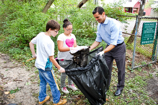 County Legislator Michael Venditto, who hosted the cleanup at Tackapausha Preserve last Saturday morning, worked a trail with John and Courtney Conaty.