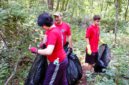 Wantagh Troop 96 Boy Scouts Bobby Zuch, left, and Brian Walker joined Scoutmaster Andy Zuch in a section of the preserve, south of Jerusalem Avenue in Seaford.